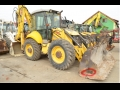 Vand BULDOEXCAVATOR Caterpillar New Holland